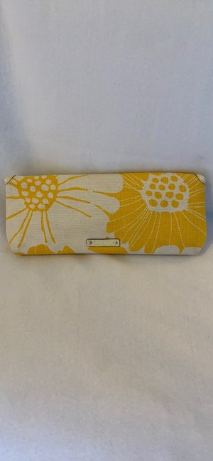 kate-spade-bloomington-mirra-yellow-and-white-canvas-clutch-1-0-650-650
