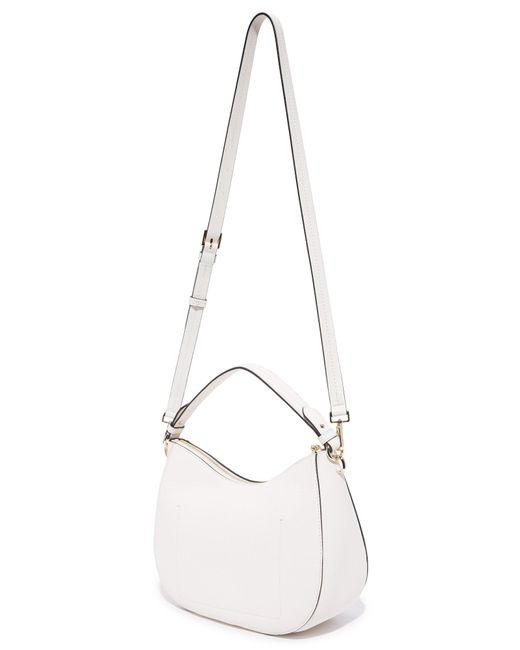 kate-spade-new-york-hayes-street-small-aiden-tassled-cement-pebbled-leather-hobo-bag-3-2-650-650