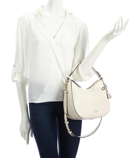 kate-spade-new-york-hayes-street-small-aiden-tassled-cement-pebbled-leather-hobo-bag-5-1-650-650