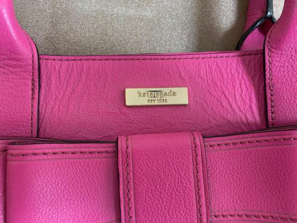 kate-spade-with-bow-and-polka-dot-lining-pnk-leather-tote-2-1-650-650